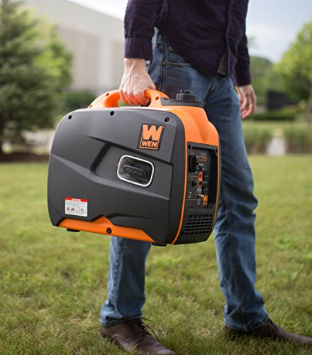 man carrying the super quiet portable WEN 56200i 2000W generator