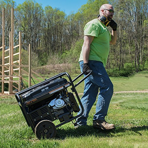 adult male hauling the Westinghouse WGen5500 portable generator