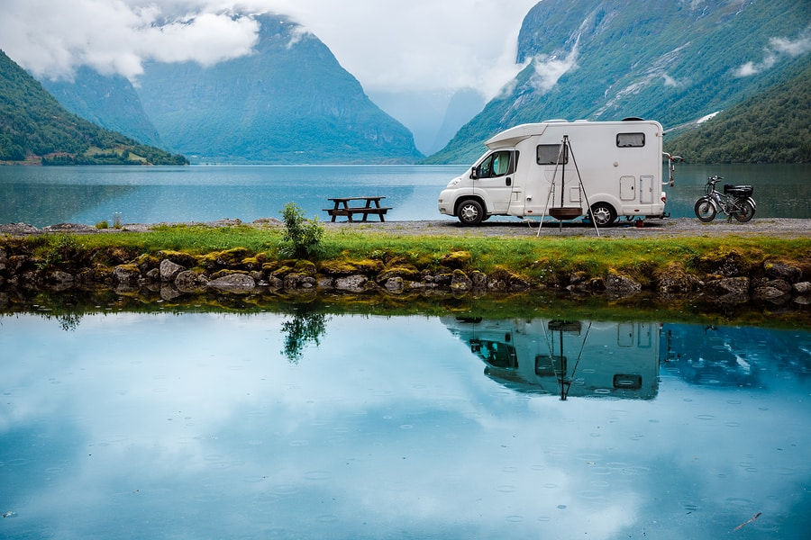 Campervan On A Lake With Mountains
